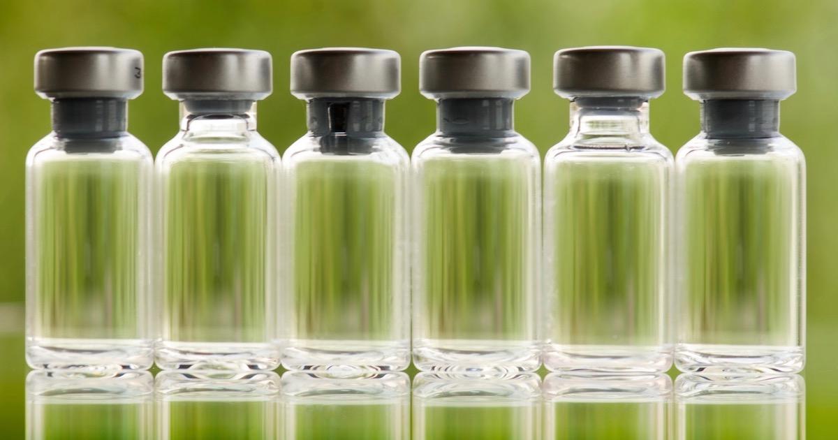 green fluid in six flasks in a row