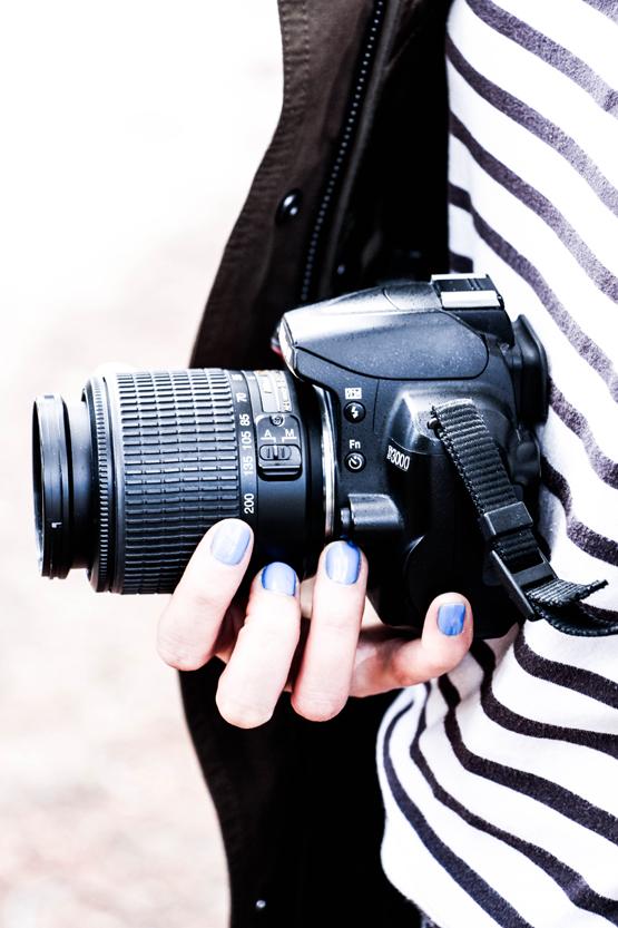 Siempre lista para disparar con su Nikon.