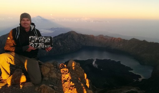 Sunrise at the summit. The caldera, volcanic lake and full moon are in the distance