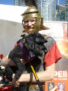Victor poses with ROM Pompeii exhibit promoter and reluctant dog handler