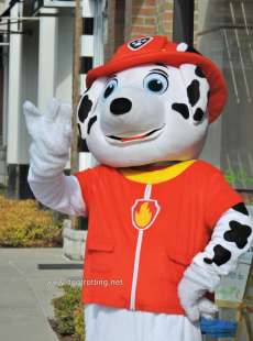 Large Paw Patrol costumed charater waving on street