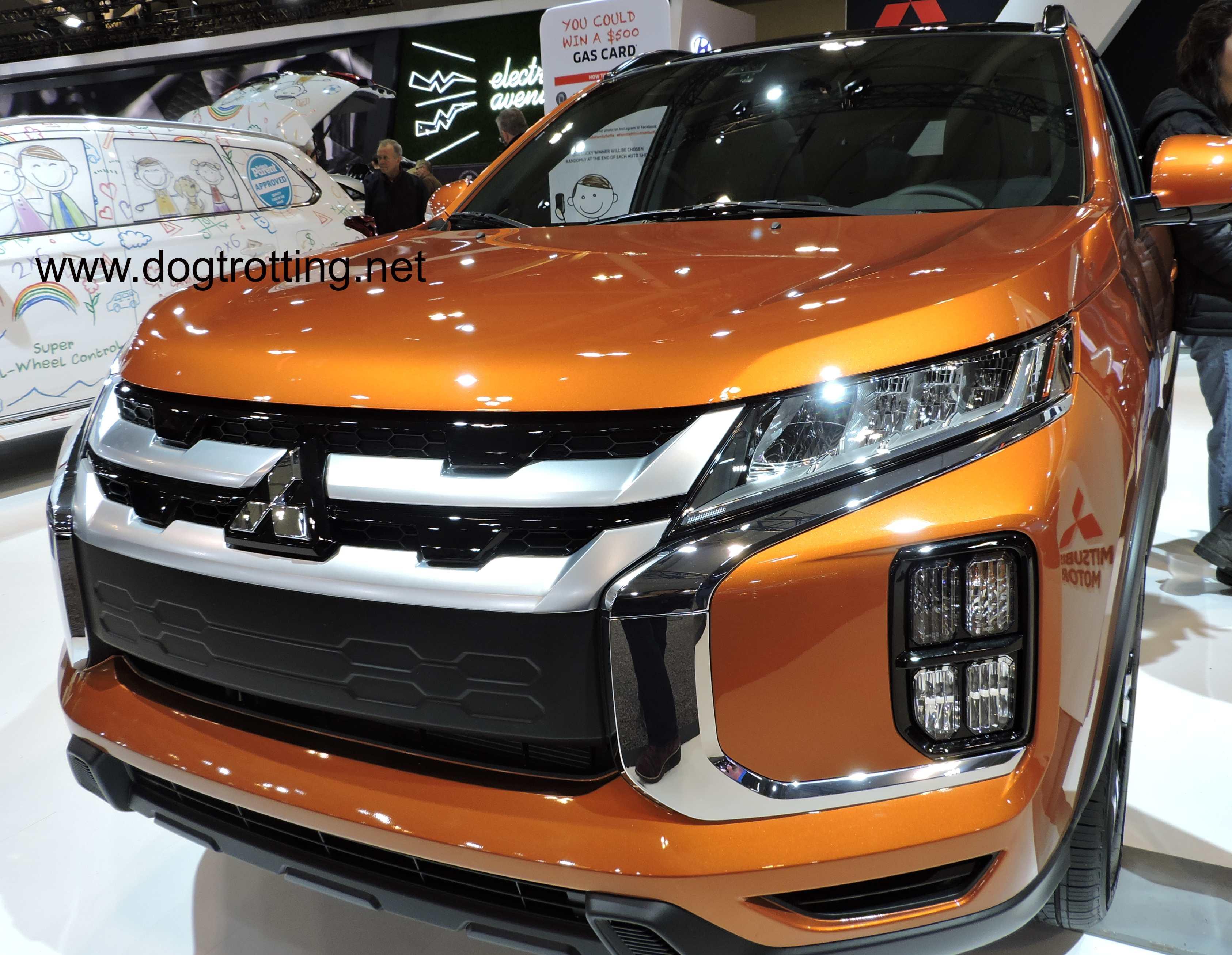 orange Mitizubishi RVR car at auto show