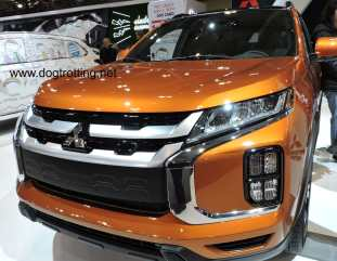 orange Mitizubishi RVR car at auto show