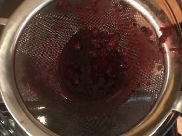 Straining blackberry juice