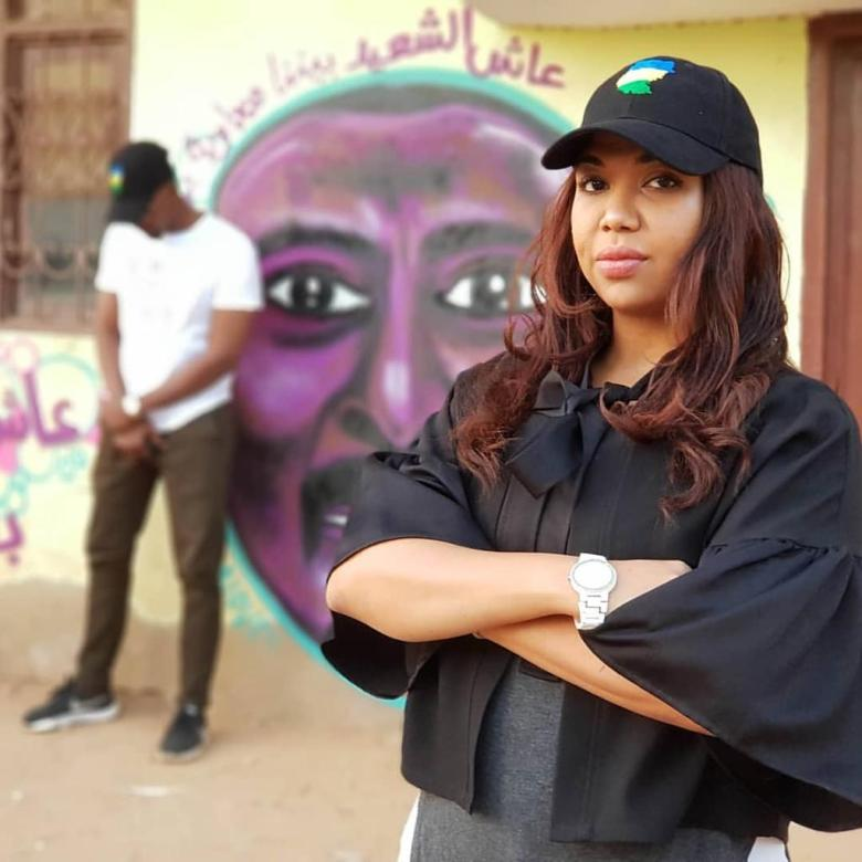 Assbil Diab and one of her graffiti works