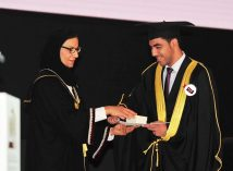 QU President awards male student