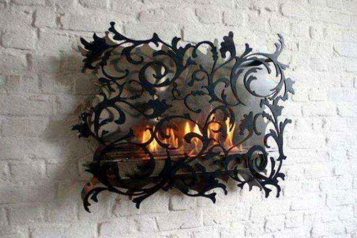 2-1-wood-burning-fireplace-ideas-decoration-in-interior-design-brick-masonry-finishing-white-wall-wrought-forged-decorative-screen-grid-black-metal1 | Дровяные камины: обзор материалов и лучших идей (Часть первая)
