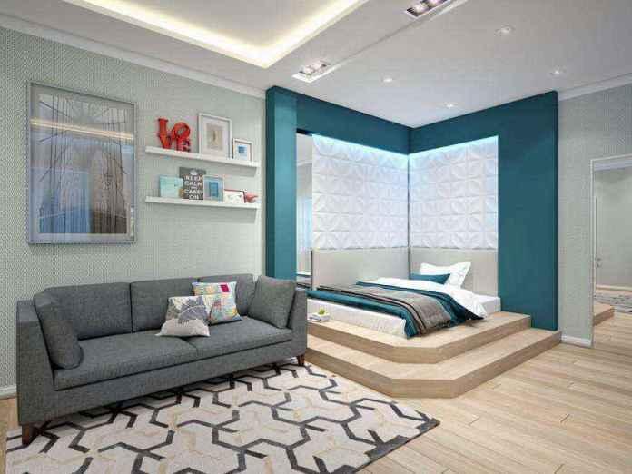 3-1-podium-bed-in-interior-design-contemporary-style-bedroom-light-gray-and-blue-geometrical-motifs-carpet-sofa-3d-wall-panels | Кровати с подиумом в дизайне интерьера: 5 реальных проектов в деталях