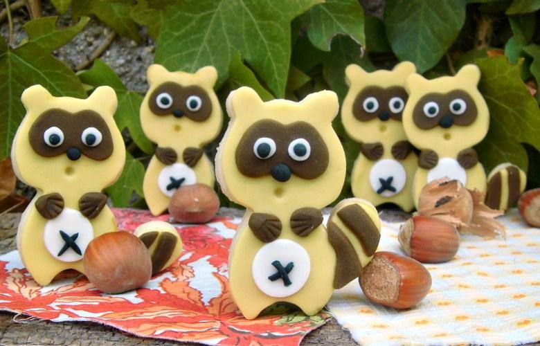 raccoon decorating cookies