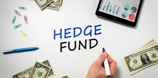 the words hedge fund written on a white table next to some piles of dollar bills