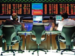 two business men in chairs looking at sao paulo stock exchange