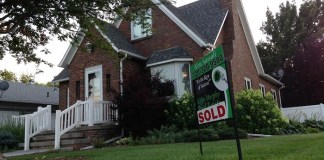 big residential property with sold sign