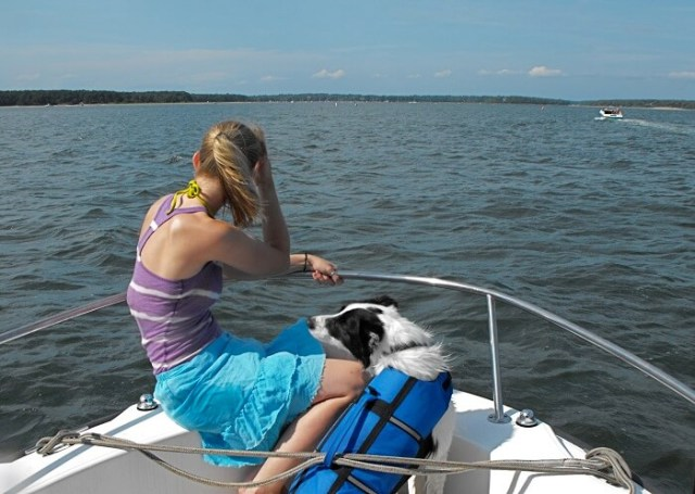 woman and dog on a boat
