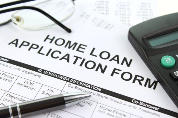 Embrace Home Loans Application Form with Complete Details, Pen, Eyeglasses, and Calculator