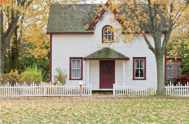 prime lending: white-and-red wooden house with fence