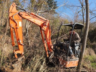 Excavator In Orchard