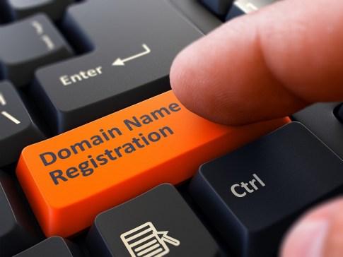 Finger Presses Orange Keyboard Button Domain Name Registration.