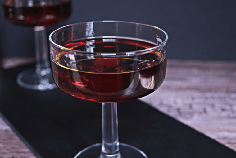 Sweet (red) vermouth, dark rum, and honey simple syrup make up this cocktail that's sweet, herbal, and perfect to end your day with.