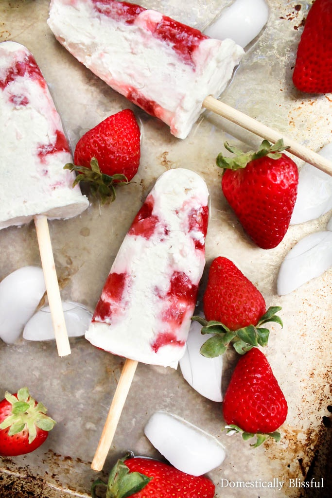 "Strawberries & Cream Popsicles Recipe | Domestically Blissful ""These easy homemade Strawberries & Cream Popsicles are a fun & delicious way to cool off while enjoy your favorite summer fruit!"""