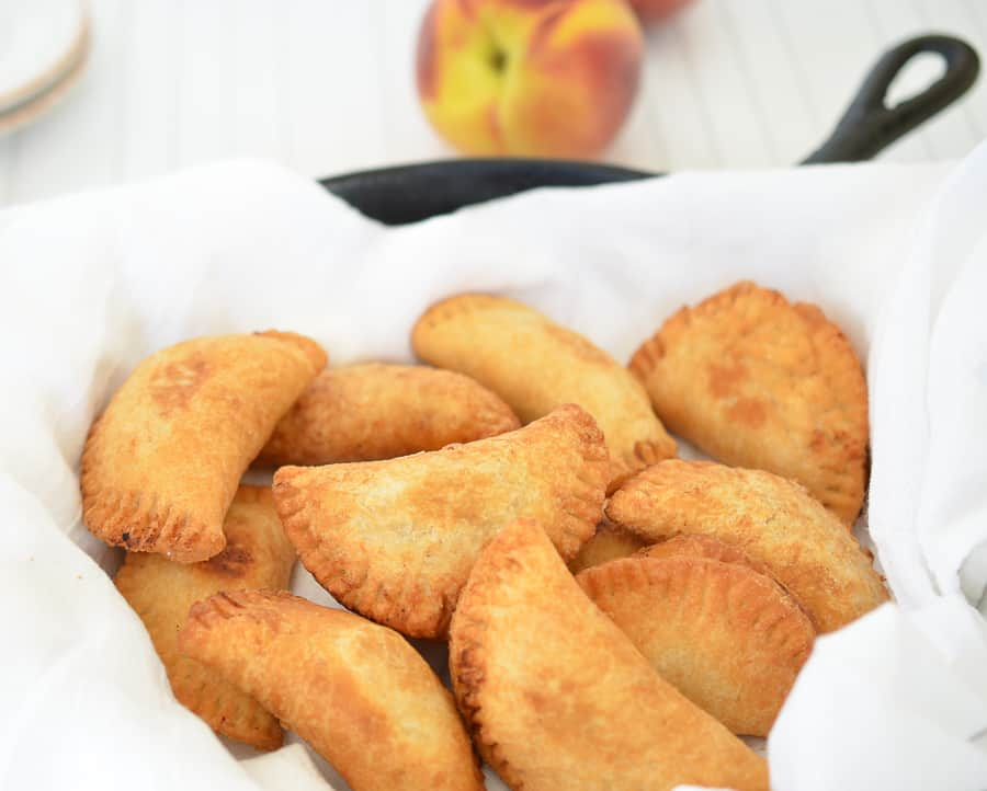 Fried Peach Pies- These mini fried peach pies are crispy,flaky and delicious.They are filled with acinnamon peach filling then fried to perfection. domesticdee.com