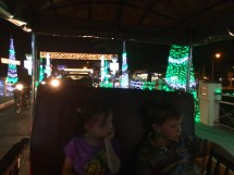 It may be a tuk-tuk instead of a sleigh, but even in Cambodia we can tour the Christmas lights