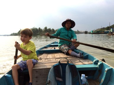 Cian helping to paddle the long boat