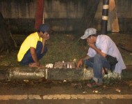 An evening game of chess along the road