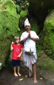 Cian posing respectfully with the Brahmin priest of the ravine