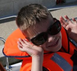 Sunglasses and lifejacket a bit too large
