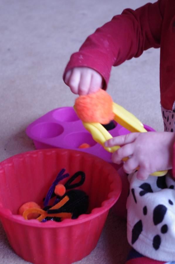 teaching using tweezers to toddlers