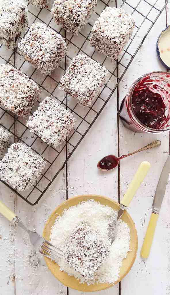 Jam lamingtons - cubes of vanilla sponge cake filled with jam & coated in chocolate & coconut - Domestic Gothess