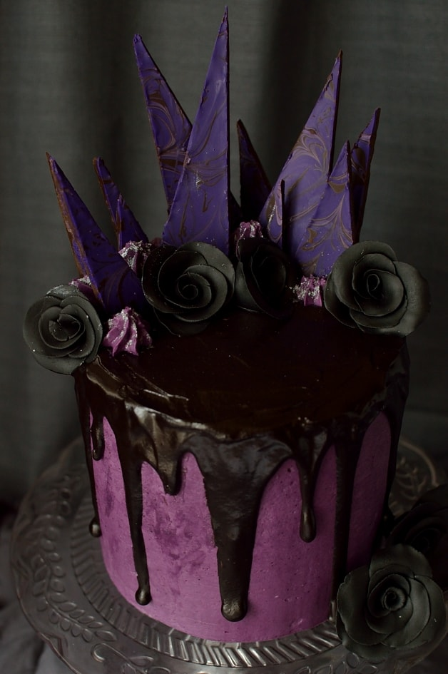 Chocolate and blackberry gothic Halloween cake with blackberry jam, blackberry swiss meringue buttercream and blackberry ganache