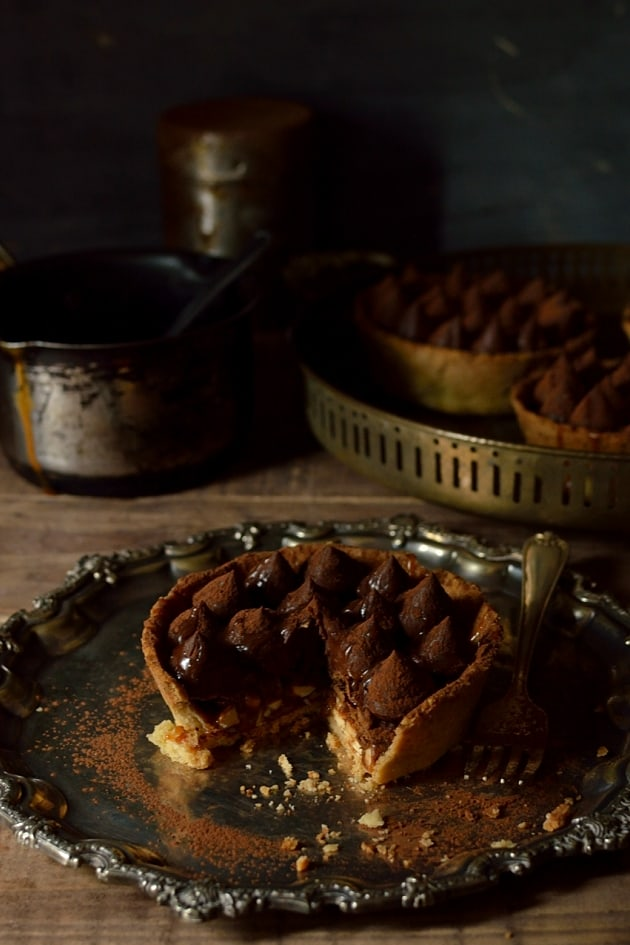 Sweet shortcrust pastry tarts filled with hazelnut salted caramel, chocolate feuilletine and dark chocolate cremeux