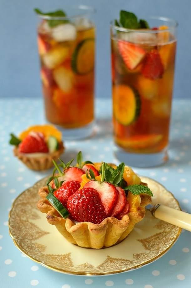 Pimm's fruit tarts - crisp citrus pastry filled with cucumber & mint jam, Pimm's creme patissiere, strawberries, orange & cucumber