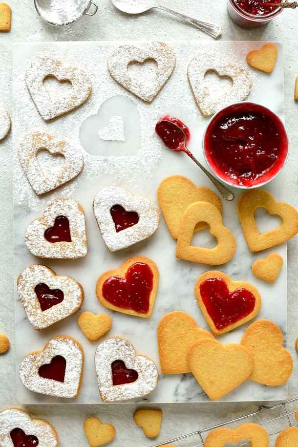 Valentine's Day Linzer biscuits (cookies) - delicious heart shaped almond biscuits filled with raspberry jam.