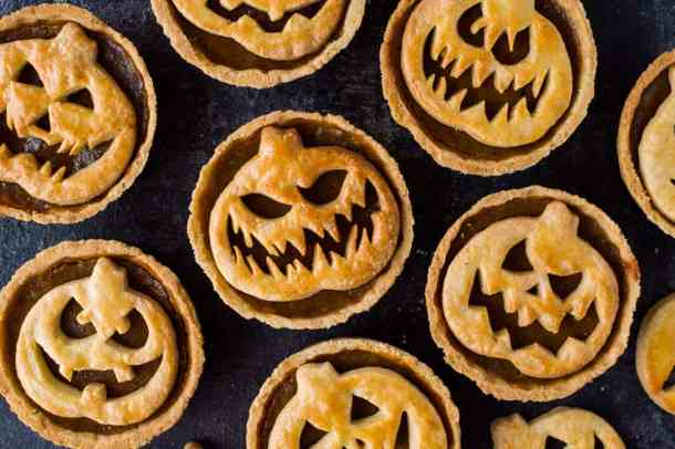 Single serving pumpkin pies with creepy Jack-O-Lantern faces.