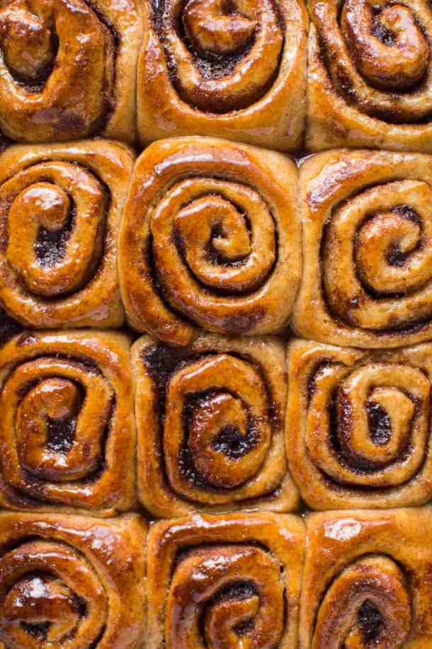 Top down photo of glazed vegan wholemeal cinnamon buns.