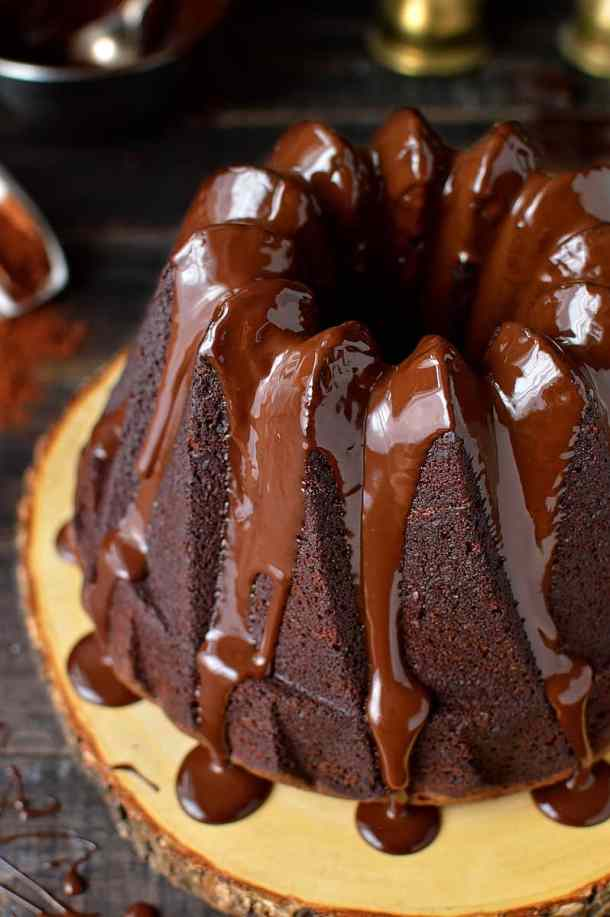 Close up shot of double chocolate bundt cake with shiny chocolate ganache glaze.