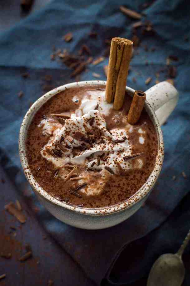 Thick, creamy vegan gingerbread hot chocolate - rich and lusciously thick vegan hot chocolate with gingerbread spices. Made with cashews, sweetened with dates; refined sugar free.