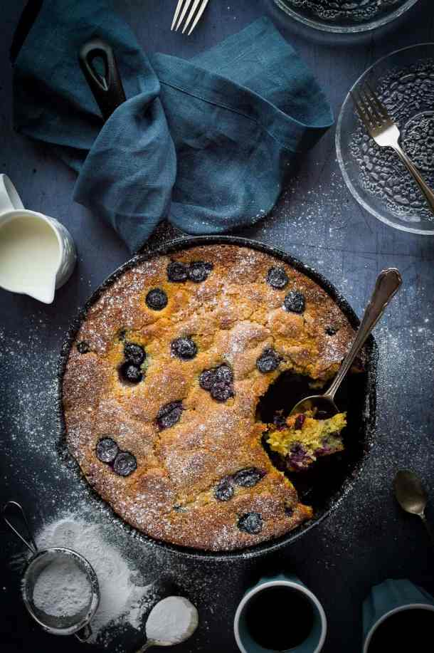 Blueberry cornmeal skillet cake - perfect as pudding, a snack or even for breakfast; this skillet cake is moist, buttery and incredibly moreish!