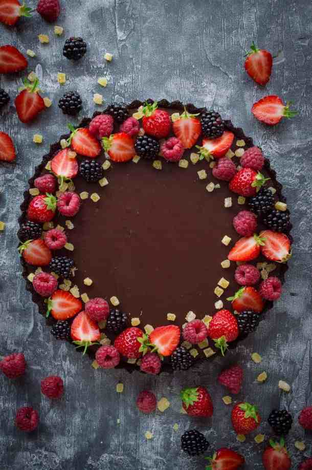 No-bake chocolate tart with stem ginger - an easy vegan chocolate tart with Oreo crust, chocolate ganache and stem ginger. This tart is super quick and easy to make but looks impressive and tastes incredible!