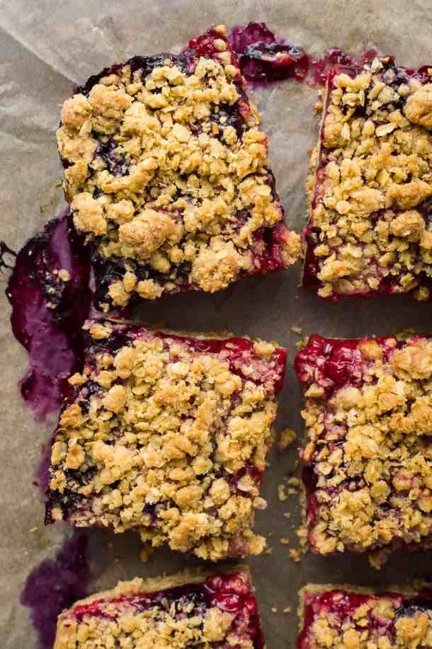 Close up of squares of vegan berry crumble bars.