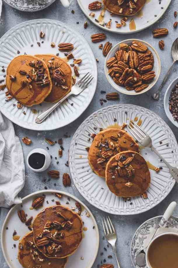 Vegan pumpkin pancakes - super fluffy, lightly spiced, easy to make and utterly delicious; these pancakes are perfect for a cozy Autumn breakfast. #vegan #pumpkin #pumpkinspice #pancakes #brunch