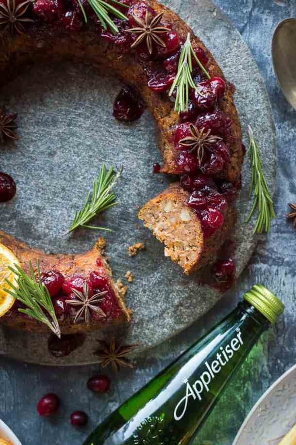 Sliced vegan nut roast wreath made with butternut squash, mushrooms and chestnuts with a bottle of Appletiser