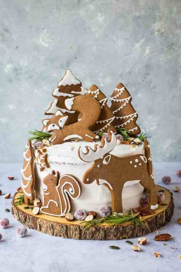 Woodland animal ginger cake - this impressive vegan ginger cake with lemon curd, cream cheese frosting and whimsical gingerbread woodland animals is a real festive showstopper for Christmas! #vegan #Christmas #gingerbread