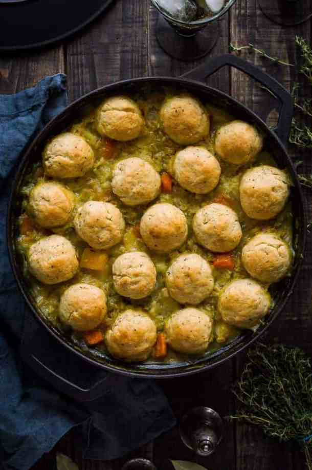 Winter vegetable and pearl barley stew with herby dumplings – a hearty, healthy and filling vegan vegetable stew topped with fluffy, herby dumplings. The perfect meal to warm you up on chilly days. #vegan #healthy