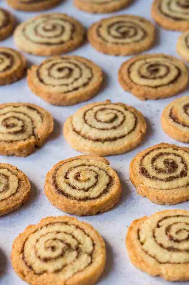 vegan cinnamon roll cookies on a grey background.