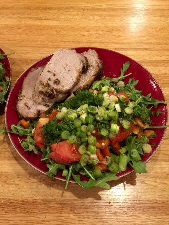 plated pork loin with salad