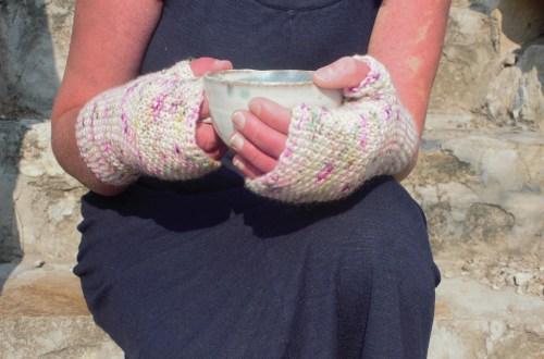 Purl Bee Soho Fingerless Seed Mittens with coffee cup in hands.
