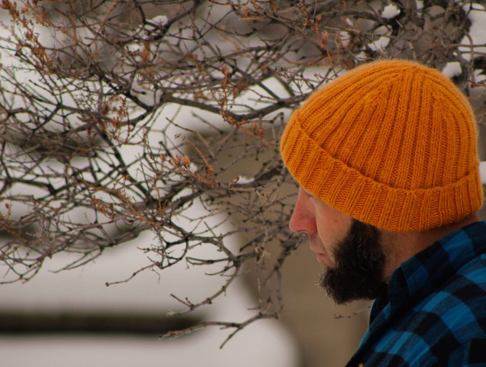 Jason Garber wearing hand knit Two-By-Two free knitting pattern hat for men.